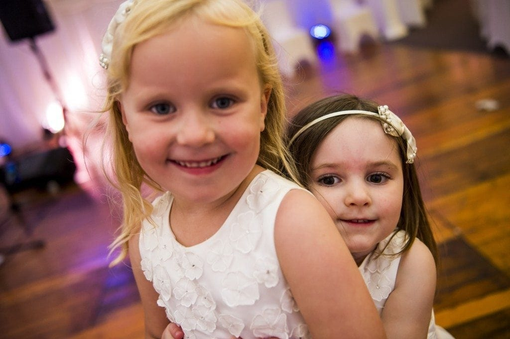 hugs on the dance floor between the flower girls at the ramside hall wedding