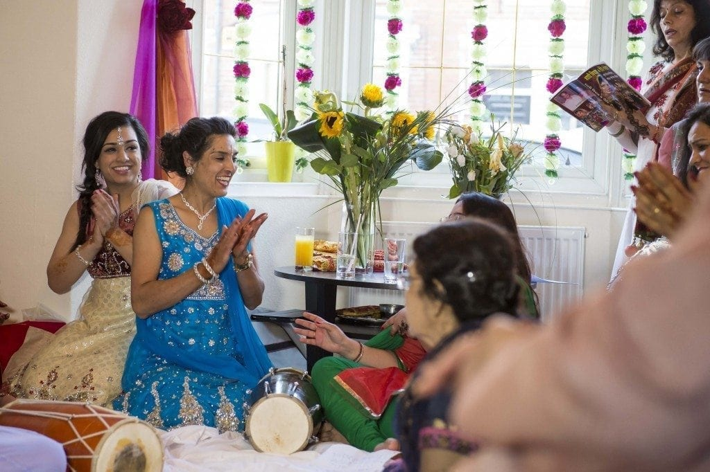 asian wedding photographer Leighton Bainbridge at Anjali's Sangeet night at her home in Newcastle. Great celebration